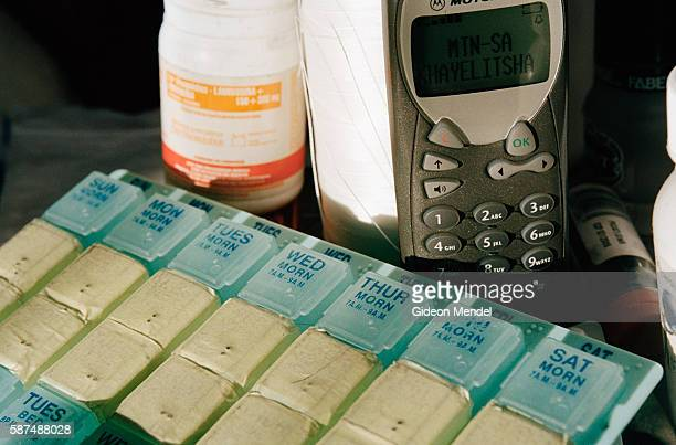 An antiretroviral pill organiser used to help with treatment compliance sits on the bedside table of TAC AIDS activist Zoliswa Magwentshu along with...