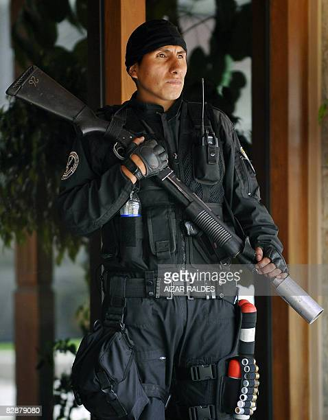 An anti-riot policeman guards the place where a meeting between Bolivian President Evo Morales and opposition governors takes place on September 18...