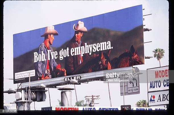 An AntiSmoking Billboard Mocking Marlboro Is On Display April 30 1997 In Los Angeles Ca As Cigarette Manufacturers Were Trying To Find Ways Out Of...