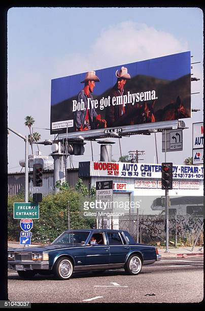 An AntiSmoking Billboard Mocking Marlboro Is On Display Near A Road April 30 1997 In Los Angeles Ca As Cigarette Manufacturers Were Trying To Find...