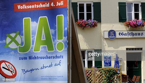 An antismoking referendum placard is seen in front of a public house in AndechsMachtlfing southern Germany on July 5 2010 Buoyed by a referendum...
