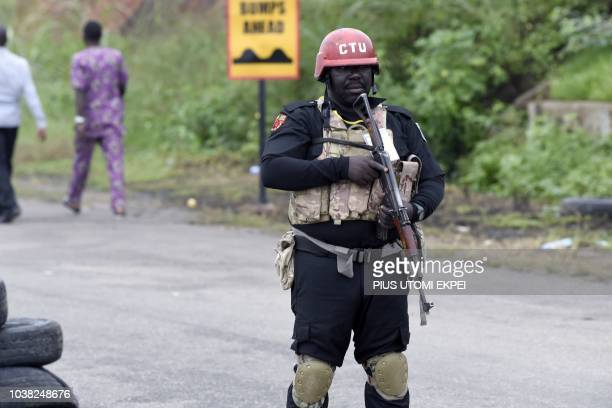 An antiterrrorism police officer stands guards at a check point during the Osun State gubernatorial election in Ede in the Osun State in southwest...