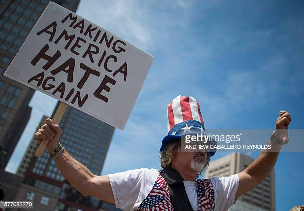 An antiTrump activist gestures during a protest outside the Republican National Convention on July 18 2016 in Cleveland Ohio Thousands of delegates...