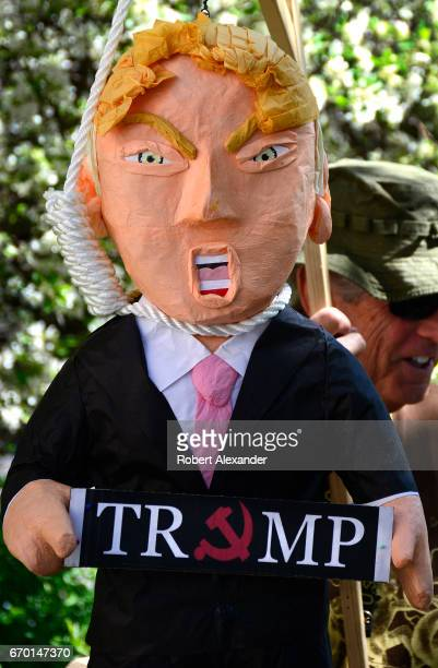 An antiTrump activist in Santa Fe New Mexico participates in a 'Tax Day' rally protesting President Donald Trump's refusal to release his income tax...