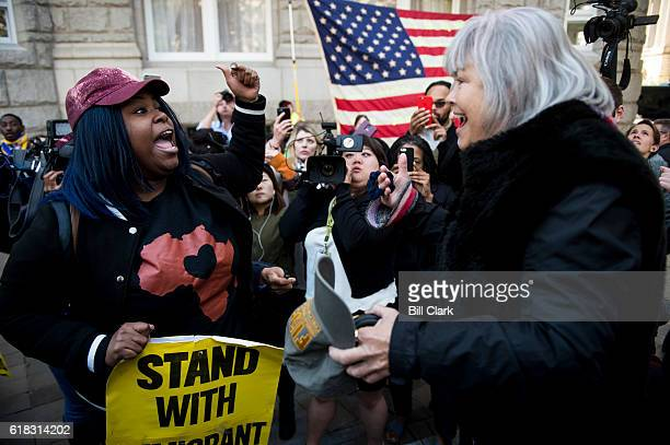 An antiTrump protester left argues with a proTrump supporter outside of the Trump International Hotel in Washington on Wednesday Oct 26 2016...