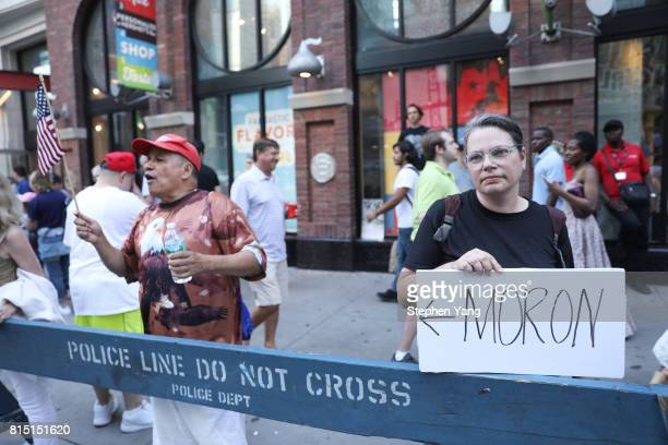 An antiTrump protester right and a ProTrump counter protester left during an AntiTrump protest on July 15 2017 in New York City