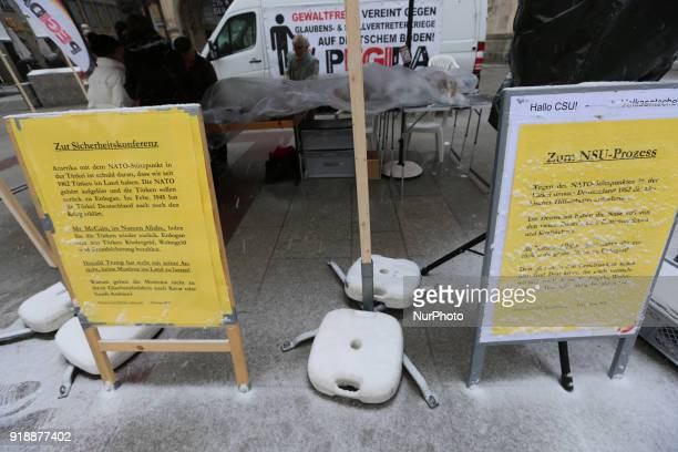 An antiturkish sign saying quotTurks must go homequot and a sign referring to the NeoNazi terror group NationalSocialist Underground are seen at a...