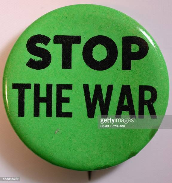 An antiVietnam War protest pin consisting of a green background and text that reads 'Stop the war' 1968