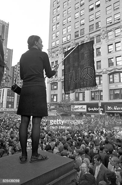 An antiwar demonstrator holds a banner above the crowd in Bryant Park during a Vietnam War protest New York New York October 15 1969 Tens of...