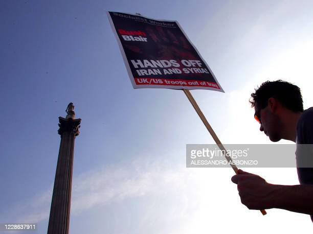 An anti-war protester arrives in Trafalgar Square in London 19 March 2005, as thousands of protesters take part in a rally to protest at the...