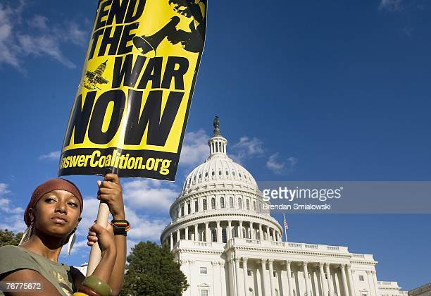 An antiwar protester holds a sign up in front of the US Capitol September 15 2007 in Washington DC Antiwar protesters first gathered for a rally near...