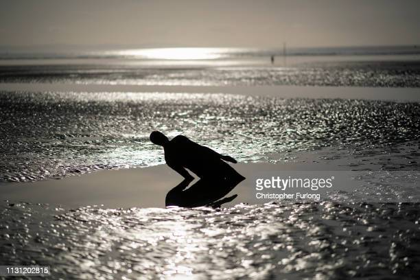 An Antony Gormley Another Place sculpture at Crosby beach on February 21 2019 in Liverpool England