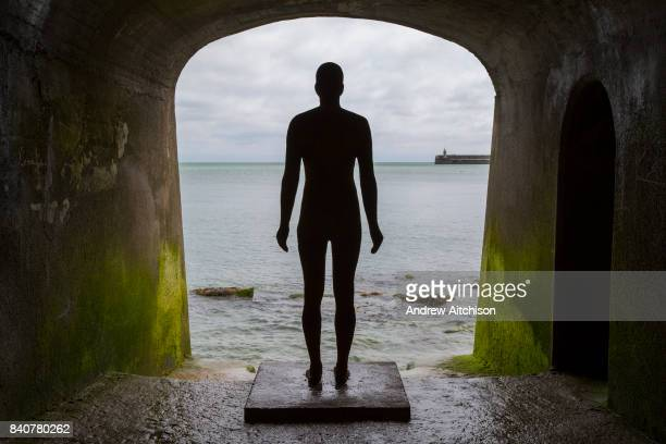 An Antony Gormley cast iron figure from the series Another Time located in the arches of Sunny Sands Bay sea defence Part of the 2017 Folkestone...