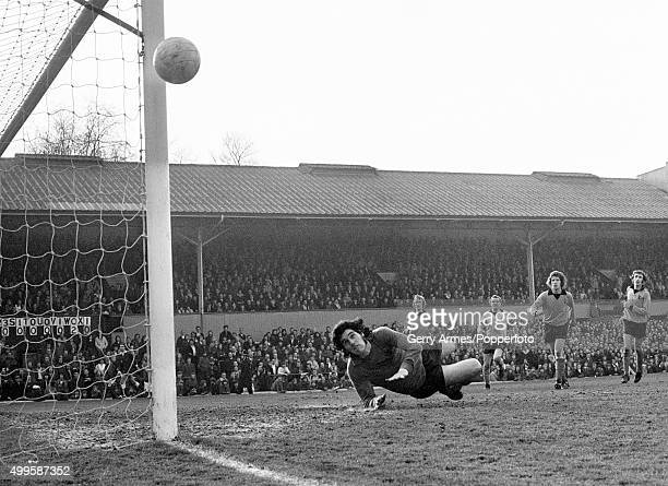 An anxious moment for a diving Wolverhampton Wanderers goalkeeper Phil Parkes who watches the ball go past the goalpost during the First Division...