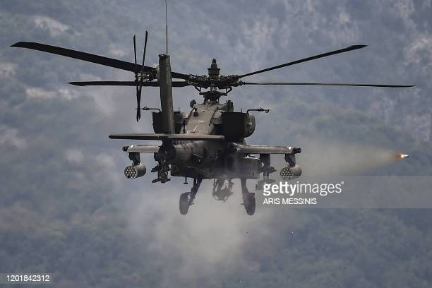 An Apache helicopter fires a missile during a Greek-American training exercise at the Litochoro firing range on February 19 2020.