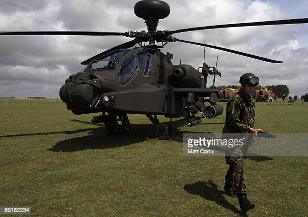 An Apache helicopter is prepared for takeoff as it takes part in a predeployment training exercise on Salisbury Plain on July 22 in Wiltshire England...