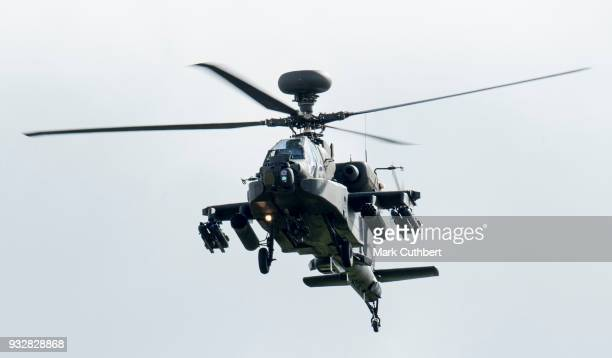 An Apache Helicopter performs a flypast after Prince Harry presented 12 pilots from Course 17/02 of the Army Air Corps with their Wing at a ceremony...