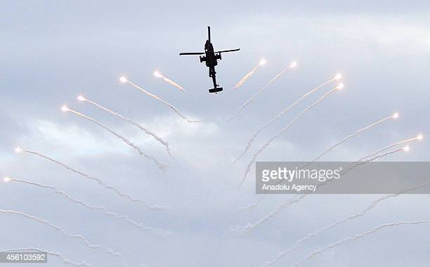 An Apache helicopter performs during Athens Flying Week in Athens Greece on 25 September 2014