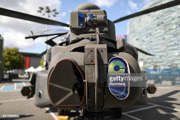 An Apache helicopter stands on display during the Defense and Security Equipment International exhibition at Excel in London UK on Friday Sept 15...