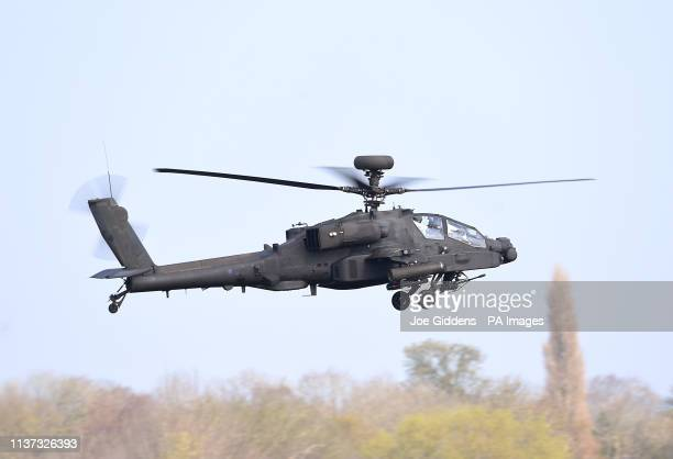 An Apache helicopter takes off from Wattisham Airfield in Suffolk as they head to the Baltics for a threemonth deployment