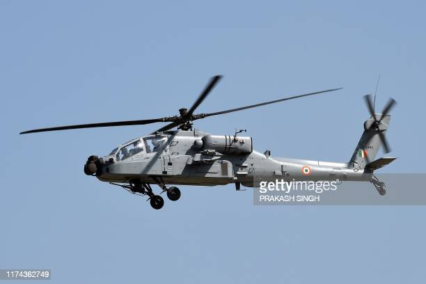 An Apache helicopters flies past during the Air Force Day parade at an IAF station in Ghaziabad, on the outskirts of New Delhi, on October 8, 2019. -...