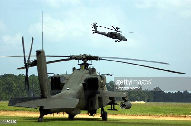 An Apache Longbow helicopter attached to the US Army Marine Division 1st Battalion 3rd Aviation Regiment returns from a training exercise October 4...