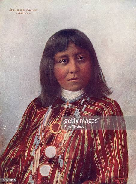 An Apache woman named Brushing Against wearing traditional clothing and jewellery