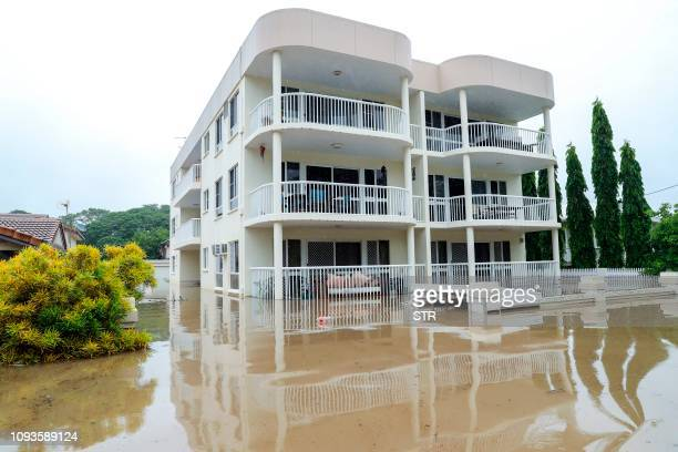 An apartment block sits in Townsville's floodwaters on February 4 as the recent downpour in Australia's tropical north has seen some areas get a...
