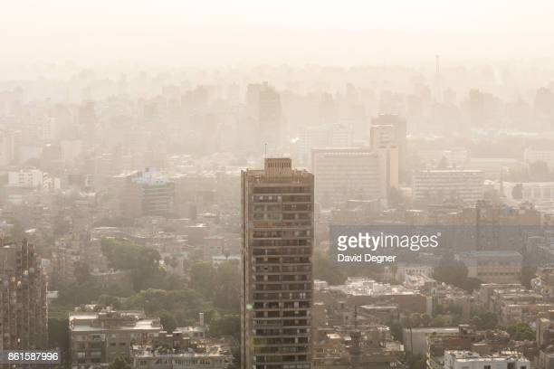 An apartment building and the Giza Skyline and pollution on September 24 2017 in Cairo Egypt Overview photos of Cairo's buildings cityscape and...