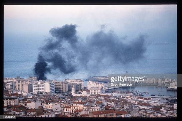 An apartment building burns October 22 1997 in Algiers Algeria Angered by the suppression of the Islamic Salvation Front when elections were...