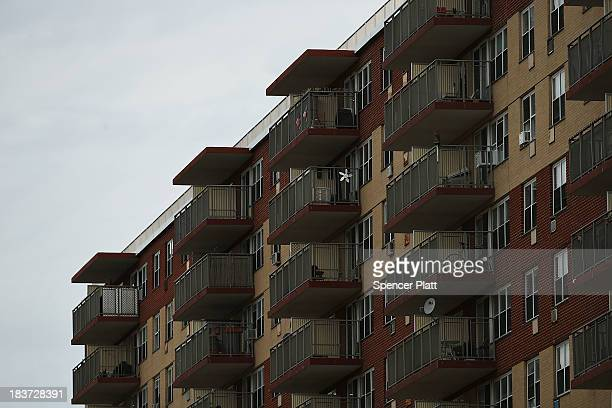 An apartment building that was heavily damaged during Hurricane Sandy stands at Rockaway beach on October 9 2013 in the Queens borough of New York...
