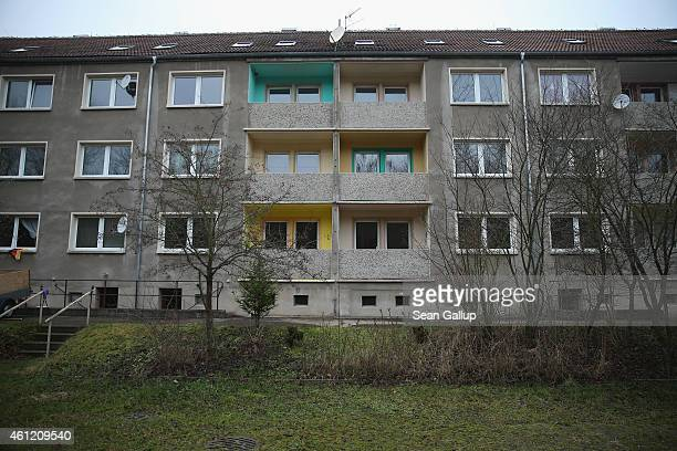 An apartment building that will soon house 50 refugees stands on January 8 2015 in Perba Germany Perba is a village of 170 residents located in...