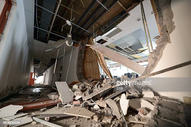 An apartment near the site of the massive explosions is seen damaged in Tianjin on August 13 2015 Enormous explosions in a major Chinese port city...