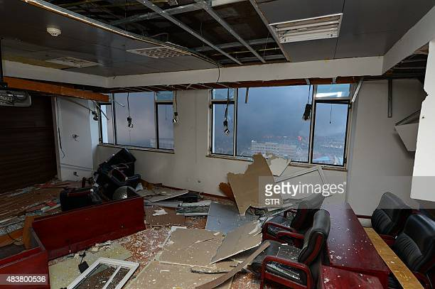 An apartment next to the site of the massive explosions is seen damaged in Tianjin on August 13 2015 Enormous explosions in a major Chinese port city...