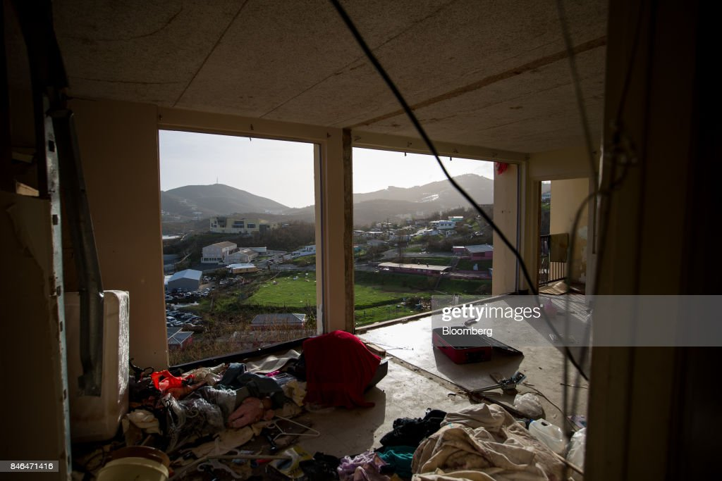 An apartment unit with missing walls is seen at the Tutu High Rise building after Hurricane Irma in St Thomas, U.S. Virgin Islands, on Tuesday, Sept. 12, 2017. After being struck by Irma last week, the U.S. Virgin Islands couldn't look less like a tourist destination. Many local residents are giving up and getting out after losing everything to the category 5 storm,even as the local authorities in the U.S. territory say they are determined to rebuild the islands. Photographer: Michael Nagle/Bloomberg via Getty Images