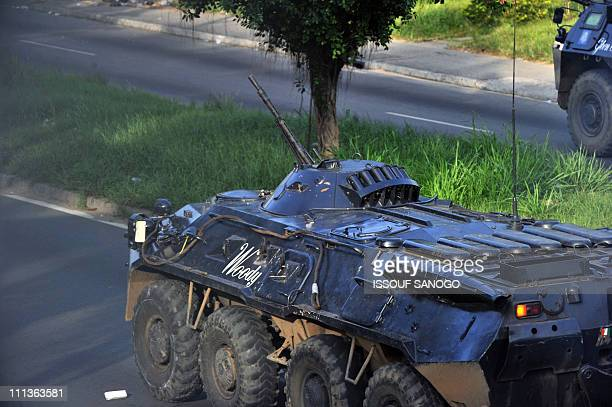 An APC of ProGbagbo militiamen patrols a street in Abidjan on April 1 2011 Ivory Coast strongman Laurent Gbagbo's forces repulsed an offensive by his...