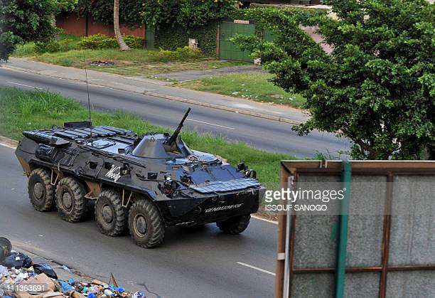 An APC of ProGbagbo militiamen patrols a street in Deux Pleaux quarter of Abidjan on April 1 2011 Ivory Coast strongman Laurent Gbagbo's forces...