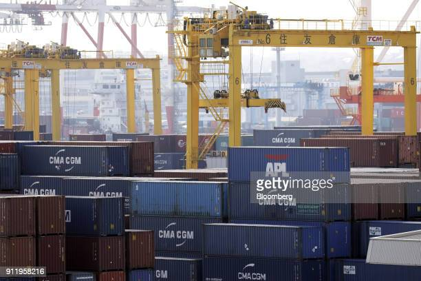 An APL Ltd container sits stacked with CMA CGM SA containers at a shipping terminal in Yokohama Japan on Monday Jan 29 2018 Japans major shipping...