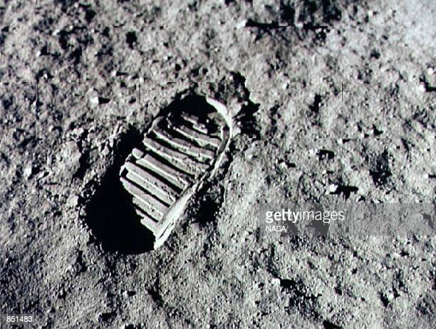 An Apollo 11 astronaut's footprint in the lunar soil, photographed by a 70 mm lunar surface camera during the Apollo 11 lunar surface extravehicular...