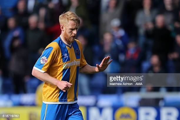 An apologetic Zak Whitbread of Shrewsbury Town walks off after being sent off during the Sky Bet League One fixture at the Greenhous Meadow on April...