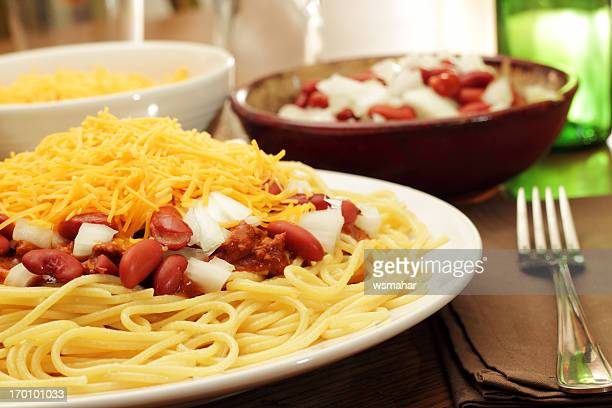 an appetizing view of freshly cooked cincinnati chili - chili stock photos and pictures