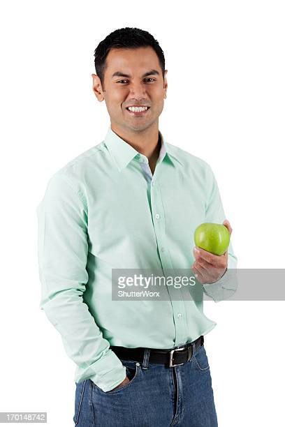 an apple a day - handsome pakistani men stock photos and pictures