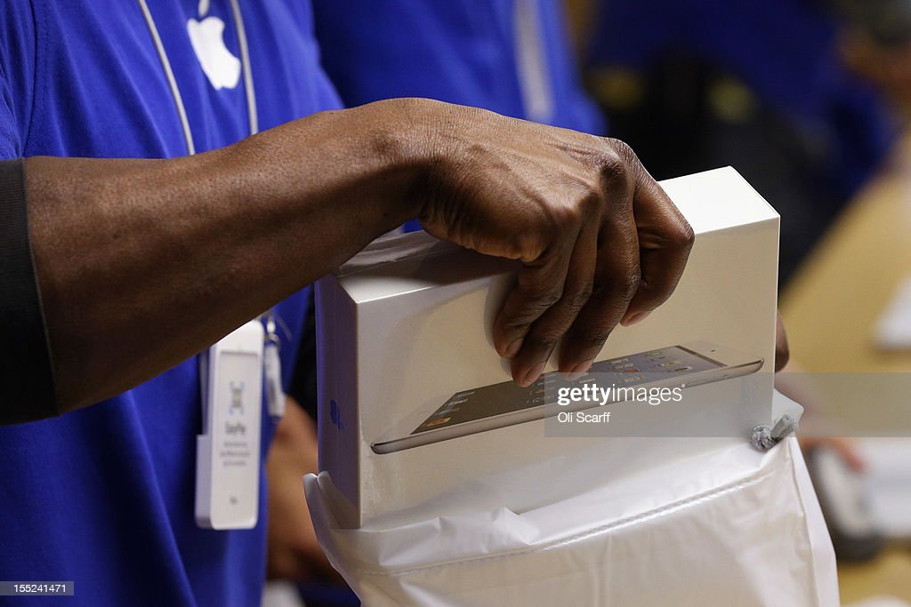 An Apple employee bags a new 'iPad mini' on the morning of the tablet's launch in the Apple Store in Covent Garden on November 2, 2012 in London, England. Customers have queued outside Apple Store branches around the world to be some of the first people to purchase the new smaller iPad tablet computer; the screen on which measures 7.9 inches diagonally compared to 9.7 inches for a regular iPad.
