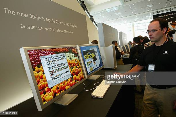 An Apple employee demonstrates a new 30inch flat panel display at the 2004 Worldwide Developers Conference June 28 2004 in San Francisco California...