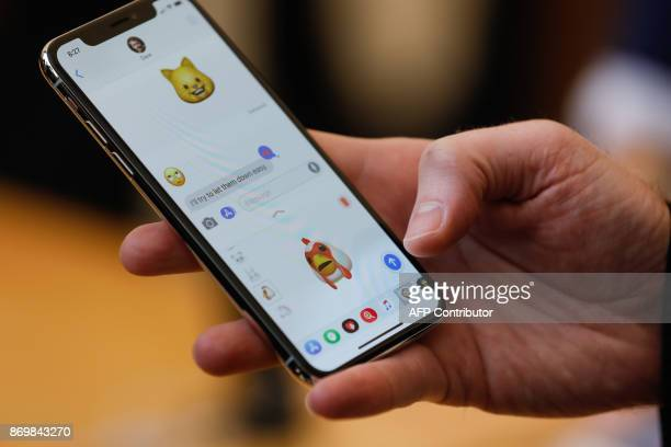 An Apple employee demonstrates the Animoji feature on the new iPhone X at the Apple Store Union Square on November 3 in San Francisco California...