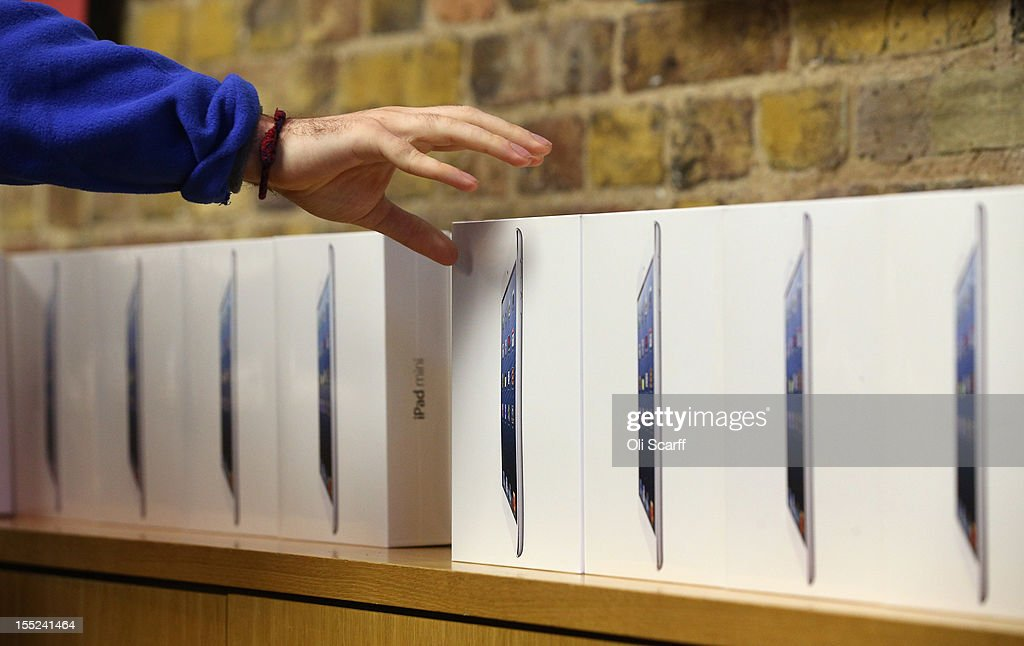 An Apple employee reaches for a new 'iPad mini' on the morning of the tablet's launch in the Apple Store in Covent Garden on November 2, 2012 in London, England. Customers have queued outside Apple Store branches around the world to be some of the first people to purchase the new smaller iPad tablet computer; the screen on which measures 7.9 inches diagonally compared to 9.7 inches for a regular iPad.