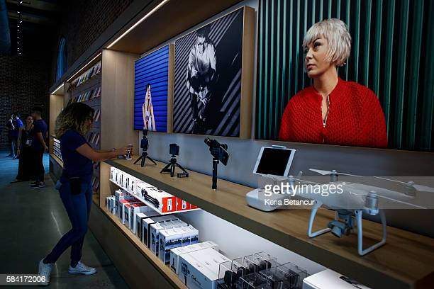 An Apple employee stands a the new Brooklyn Apple Store during a media preview in the Williamsburg neighborhood of Brooklyn on July 28 2016 in New...