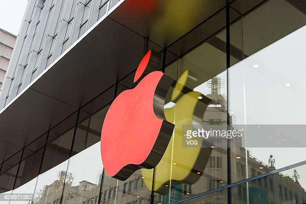 An Apple flagship store lights up the red logo in the World AIDS Day 2016 to raise awareness for the AIDS pandemic at Huangpu District on December 1...