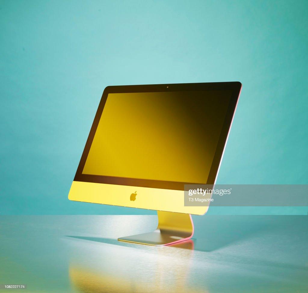 An Apple iMac 4K 21 5-inch all-in-one desktop computer, taken on