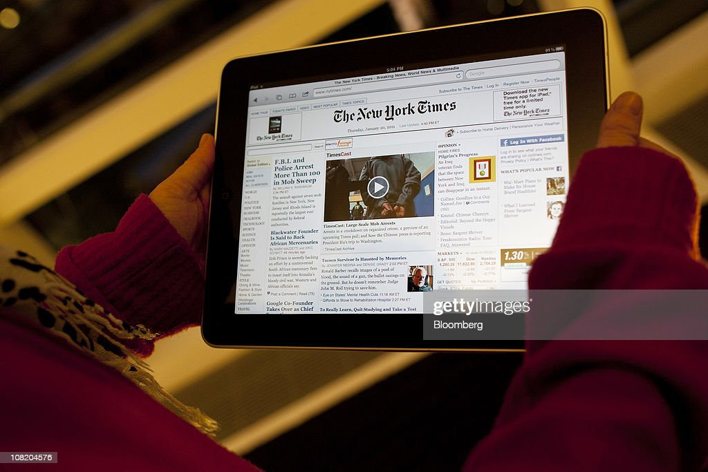 An Apple Inc  iPad tablet computer with the New York Times